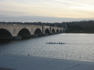 Rowers in the Potomac at sunset along Memorial Bridge